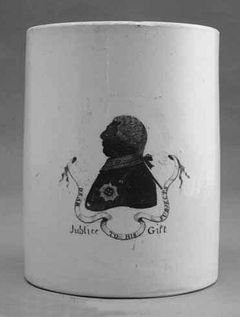 Photo of a white ceramic mug with silhouette made to commemorate George III Jubilee