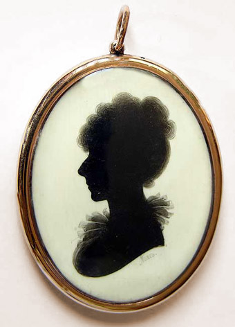 Locket with silhouette to centre, by Meirs, gold surround, ivory ground