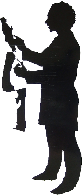 Full length silhouette of a silhouette artist facing left cutting a full length silhouette of a man