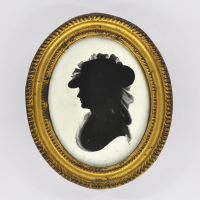 Front of Silhouette, in frame, with woman looking left