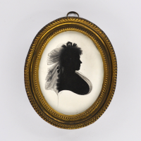 Front of silhouette, in frame, with woman looking right, with ribbon.