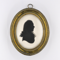 Front of silhouette, in frame, with man looking right.