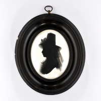 Front of silhouette, in frame, with woman looking left, with a hat with ribbon.