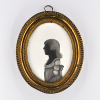 Front of silhouette, in frame, with young girl looking left.