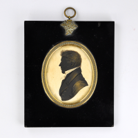 Front of Silhouette, in frame, with man looking left