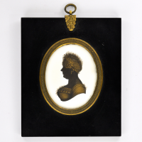 Front of silhouette, in frame, with woman looking left.