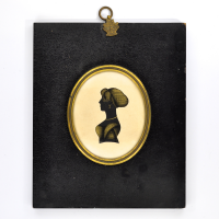 Front of Silhouette, in frame, with woman looking wearing a bonnet