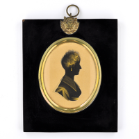 Front of silhouette, in frame, with woman looking right.