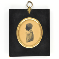 Front of silhouette, in frame, with boy looking left.