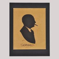 Sillhouette of a man with cigar looking right (obverse)