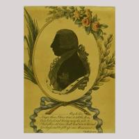 Silhouette of a man with nobel clothing facing left, framed by flowers and grinding