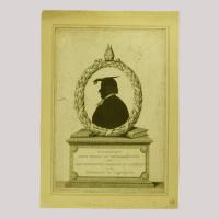 Silhouette of a man facing left, framed by a laurel wreath