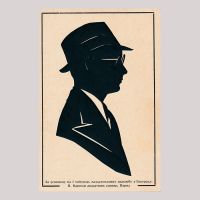 Front of silhouette, with man looking right, wearing
