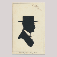 Front of silhouette, Man wearing a hat and looking to the right