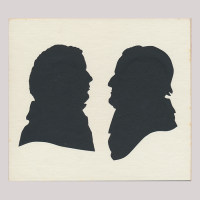 Front of silhouette, with two men. The man on the left is looking right; the man on the right is looking left and is wearing a hat.
