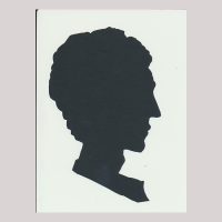 Silhouette with man looking right.