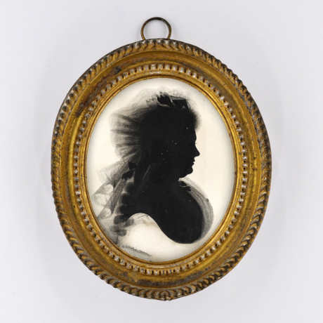 Front of Silhouette, in frame, with woman looking right