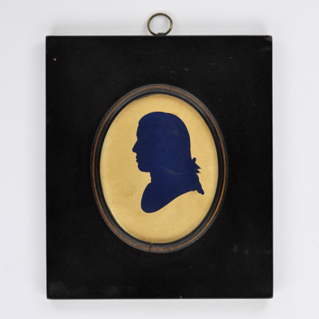 Front of silhouette, in frame, with man looking left.