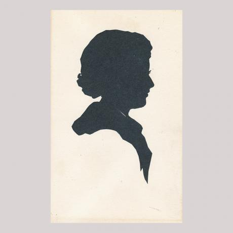 Front of silhouette, with woman looking right.