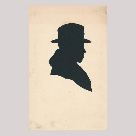 Front of silhouette, with man looking right, wearing a hat.