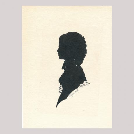 Front of silhouette, with woman looking left, wearing ribbons.