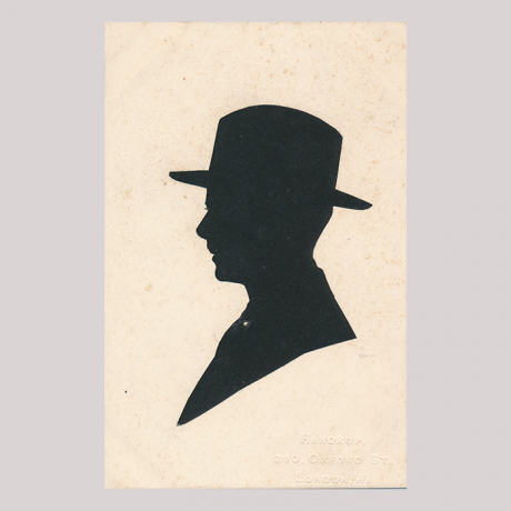 Front of silhouette, Man wearing a hat and looking to the left